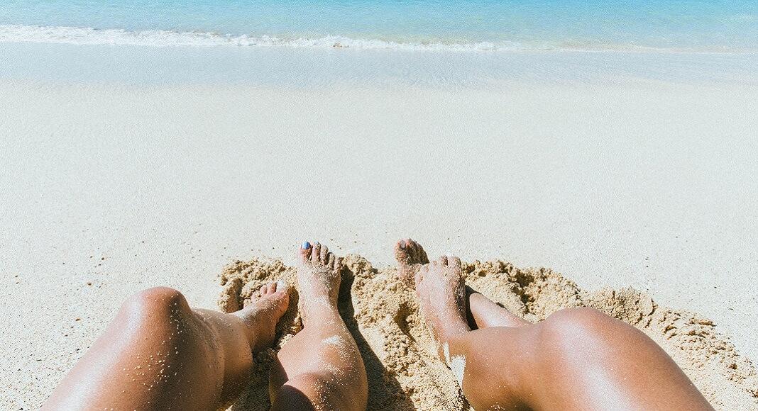 Piernas en playa